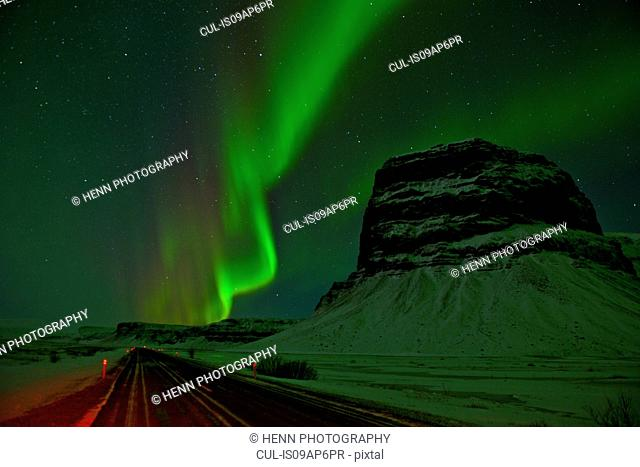 Aurora borealis at the mount Lomagnupur at night, South East Iceland