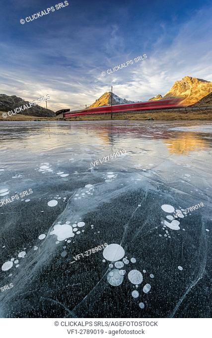 Bernina Pass, Switzerland. The iconic red train 'Glaciers Express' running away