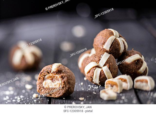 Pastry balls with marzipan and chocolate and caramel biscuit bars