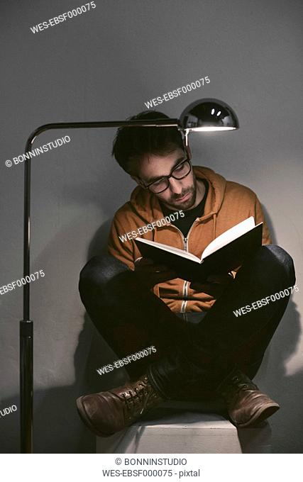 Man reading a book at home