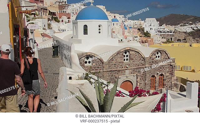 Greece Santorini Oia Cyclades white buildings and steep mountains Greek Islands beautiful peaceful place walking tourists