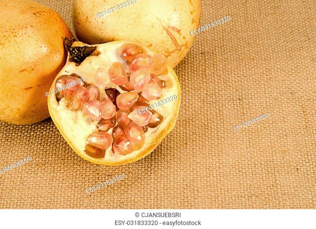Image of pomegranate on brown sack background