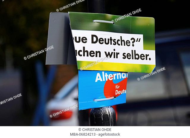 Destroyed election poster of the AFD party