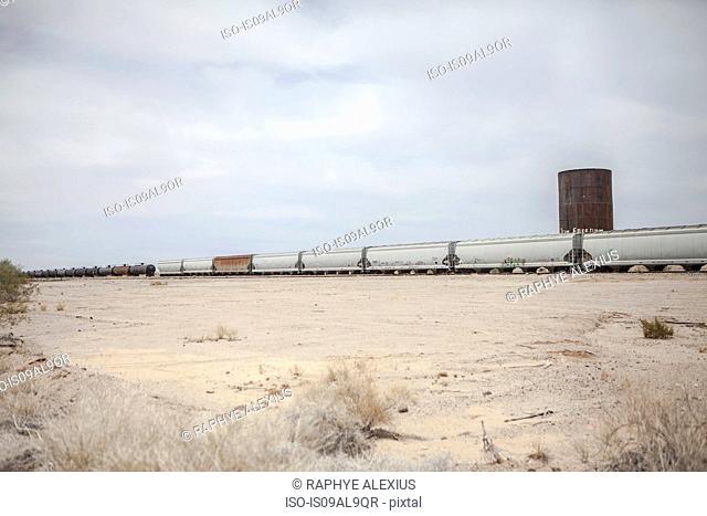 Freight train in desert landscape, California, USA