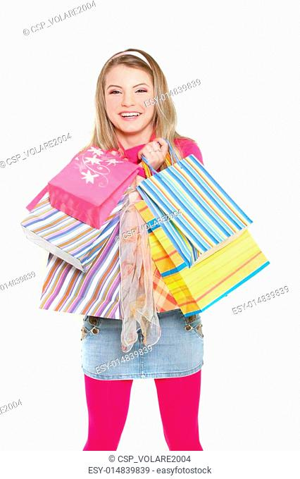 young happy girl with shopping bags over white