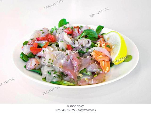 Ceviche - raw fish and seafood - marinated in lemon juice