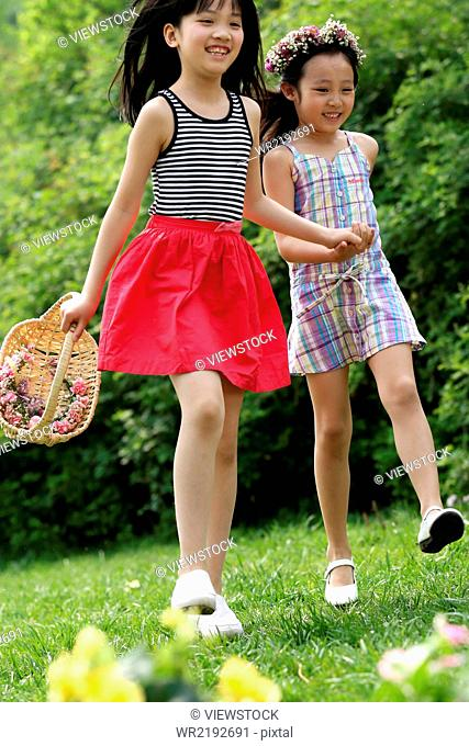 Two girls playing in field