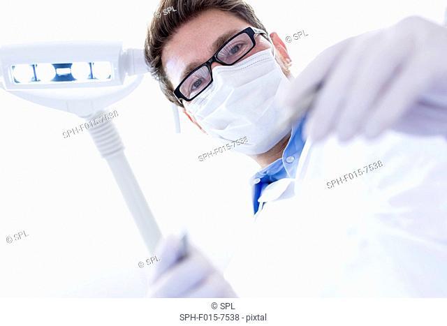 MODEL RELEASED. Dentist