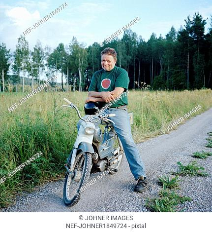 Mature man on old motorcycle