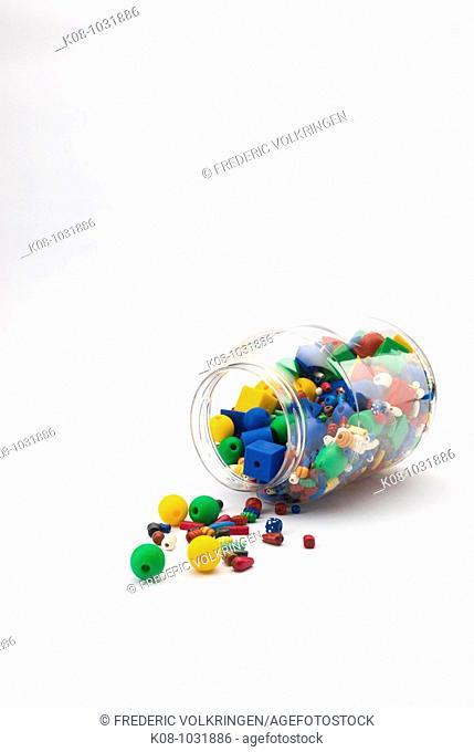 Coloured plastic pieces inside jar