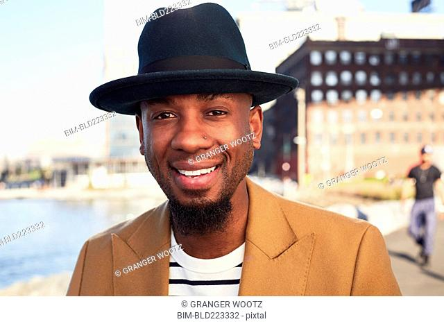 African American man smiling at waterfront