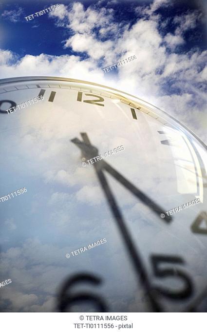 Close up of clock face and sky