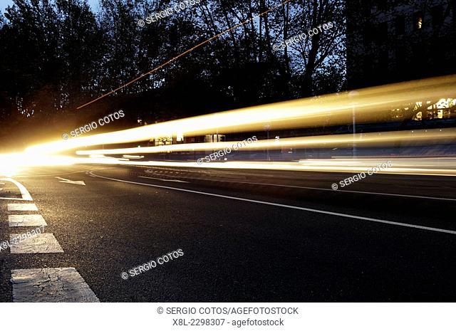 Car lights at dawn
