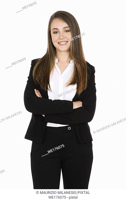 Smiling girl with long hair, she is standing with her arms crossed, wearing a black suit and white shirt