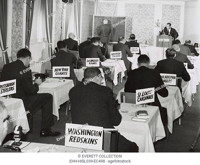National Football League draft meeting in New York, Nov. 28, 1964. Commissioner Pete Rozelle reads the picks as representatives of the various football teams...