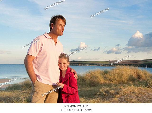 Father and daughter hugging on beach
