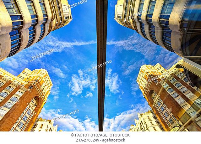 Low angle view of Carrion building and Palacio de la Prensa at Callao square. Madrid. Spain