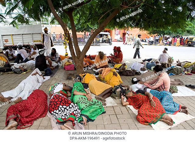 Devotees sleep under tree, Nasik, maharashtra, india, asia