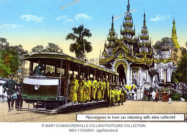 Buddhist Monks (Hpoongyees) take the tram home from the Shwedagon Pagoda - Entrance (with leogryph) with their alms - Yangon, Myanmar
