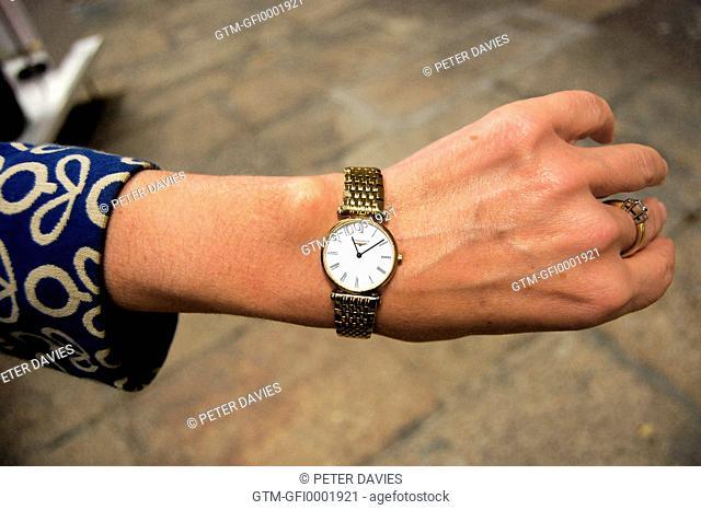 Wrist watch on ladies arm