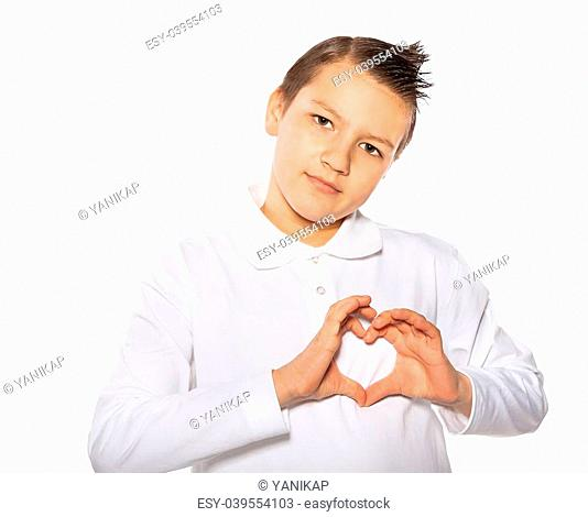the beautiful teenager the boy showing heart shape with hands