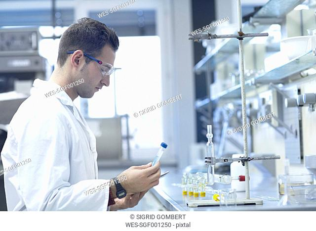 Chemist working in lab with test tube