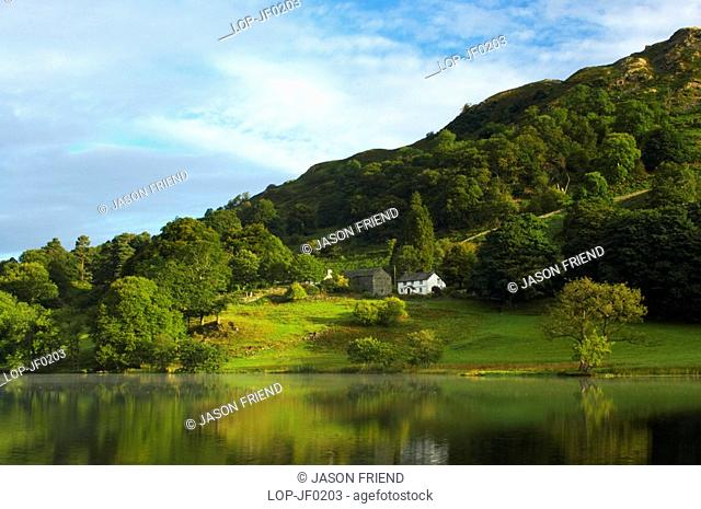 England, Cumbria, Loughrigg Tarn, Reflections of typical Lake District scenery in the still waters of Loughrigg Tarn
