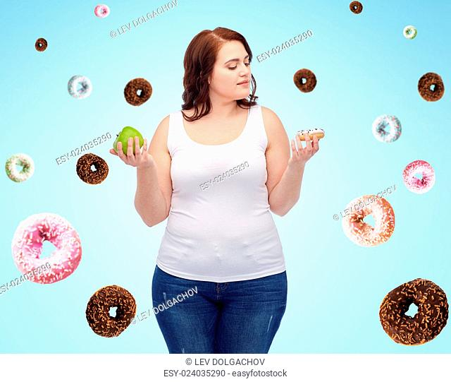 healthy eating, junk food, diet and choice people concept - plus size woman choosing between apple and cookie over blue background