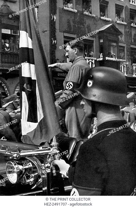 The Blood Flag of 1923, Nuremberg, Germany, 1936. Adolf Hitler (1889-1945) in Nuremberg for the Nazi Party Congress, with a flag commemorating the failed Munich...