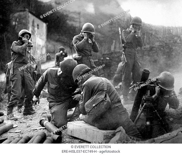 U.S. Soldiers firing mortars as they establish a beachhead on the east bank of the Rhine. March 1945. Germany, World War 2. (BSLOC-2014-8-68)