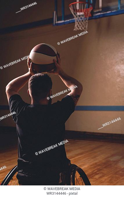 Disabled man practicing basketball in the court