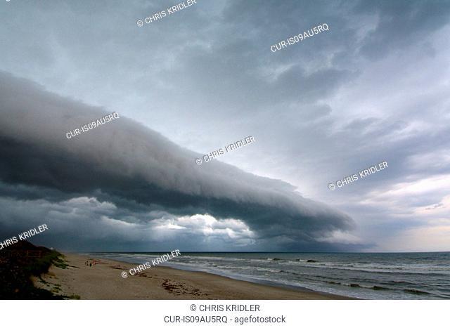 A beautiful shelf cloud, or arcus cloud, passes over the beach at Patrick Air Force Base near Satellite Beach, Florida, USA