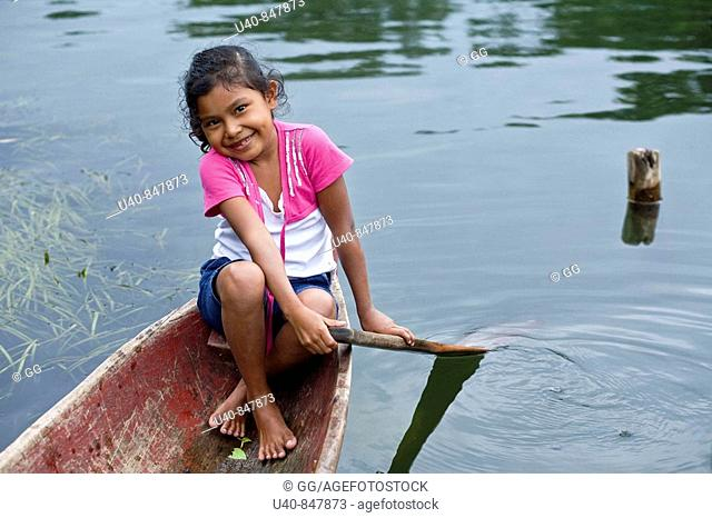 Guatemala, Rio Dulce, girl in canoe