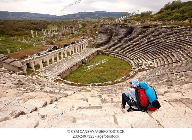 Tourist couple at the ancient theater of Aphrodisias, Aydin Province, Aegean Coast, Turkey, Europe