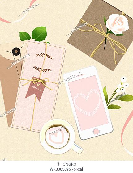 Wedding invitation card with smartphone, a cup of tea and flowers