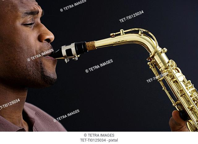 Close up of man playing saxophone