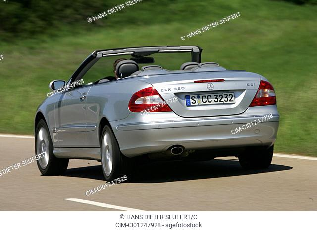 Mercedes CLK 320 CDI Convertible, model year 2005-, silver, driving, diagonal from the back, rear view, open top, country road