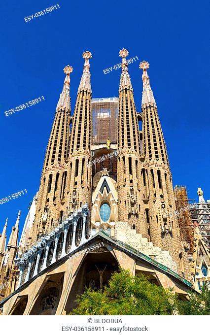 BARCELONA, SPAIN - JUNE 11: Sagrada Familia in Barcelona in Spain in a summer day