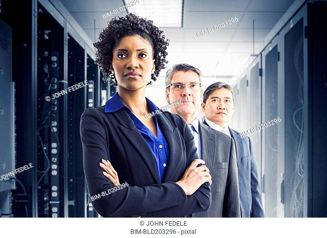 Businesspeople standing in office