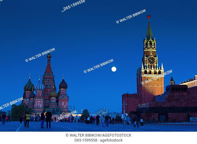 Russia, Moscow Oblast, Moscow, Red Square, Kremlin, Saint Basils Cathedral and Kremlin Spasskaya Tower with moonrise