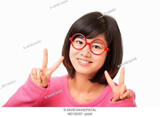 Beautiful Chinese woman displaying a bit of attitude on a white background