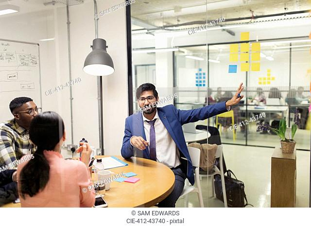 Creative businessman talking in conference room meeting