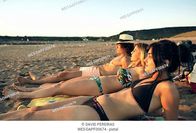 Friends relaxing on the beach