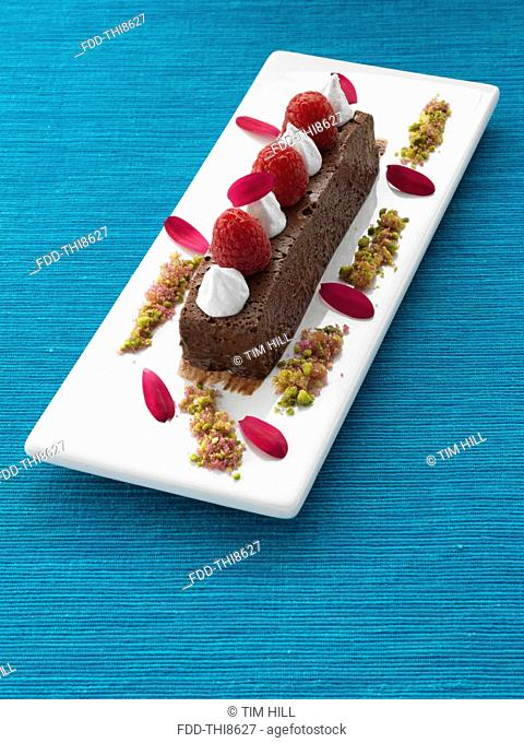 A whole chocolate marquis with raspberries and cream gourmet dessert