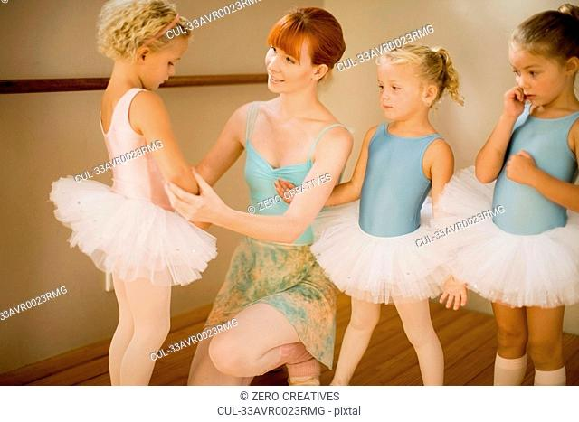 Ballet teacher talking to students