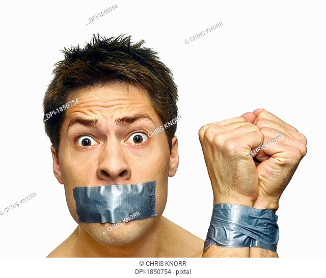 Man with tape, Man with his mouth and wrists taped