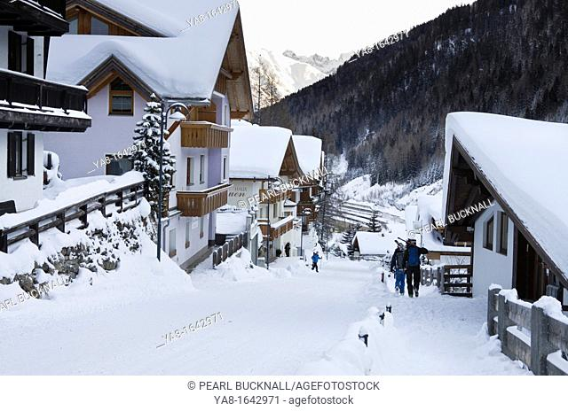 St Anton am Arlberg, Tirol, Austria, Europe  Village street scene with skiers and traditional Austrian buildings after heavy snowfall in winter