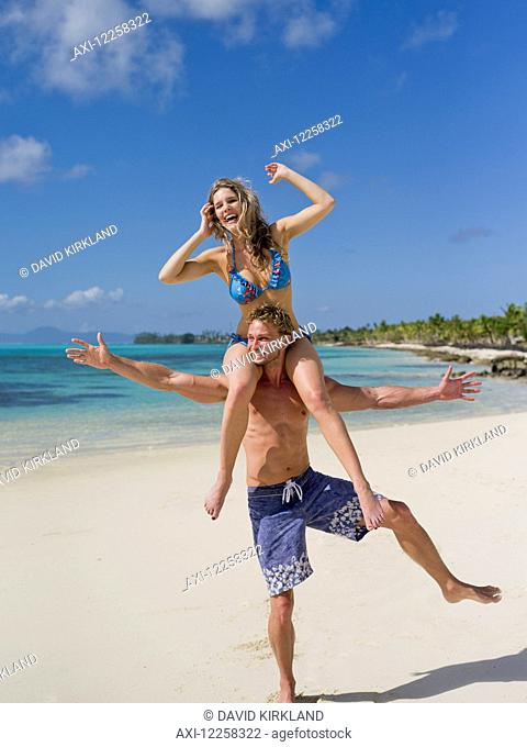 Tourists playing on the beach on Savaii Island; Savaii, Samoa