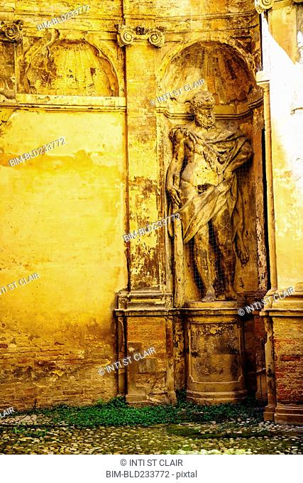 Worn statue in alcove
