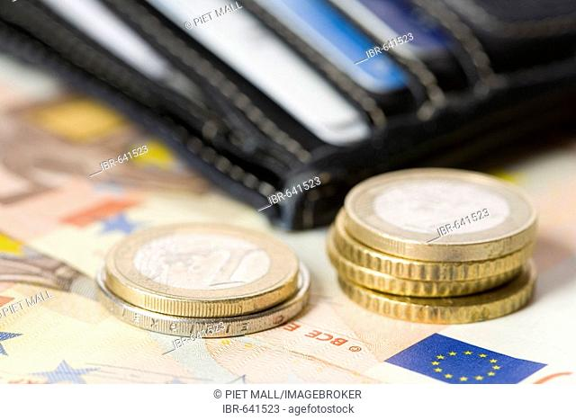 Wallet, coins, and cash (Euros)